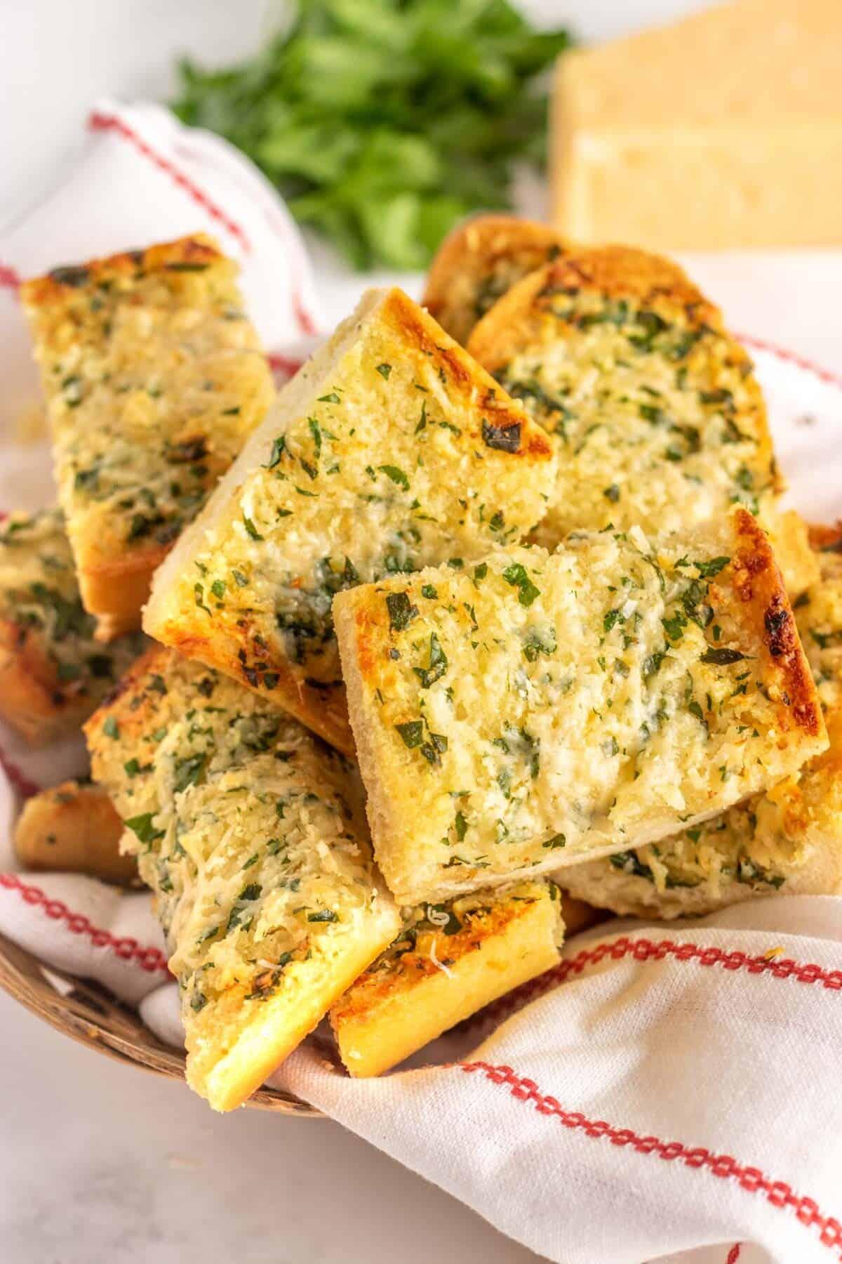 cut garlic bread in a basket