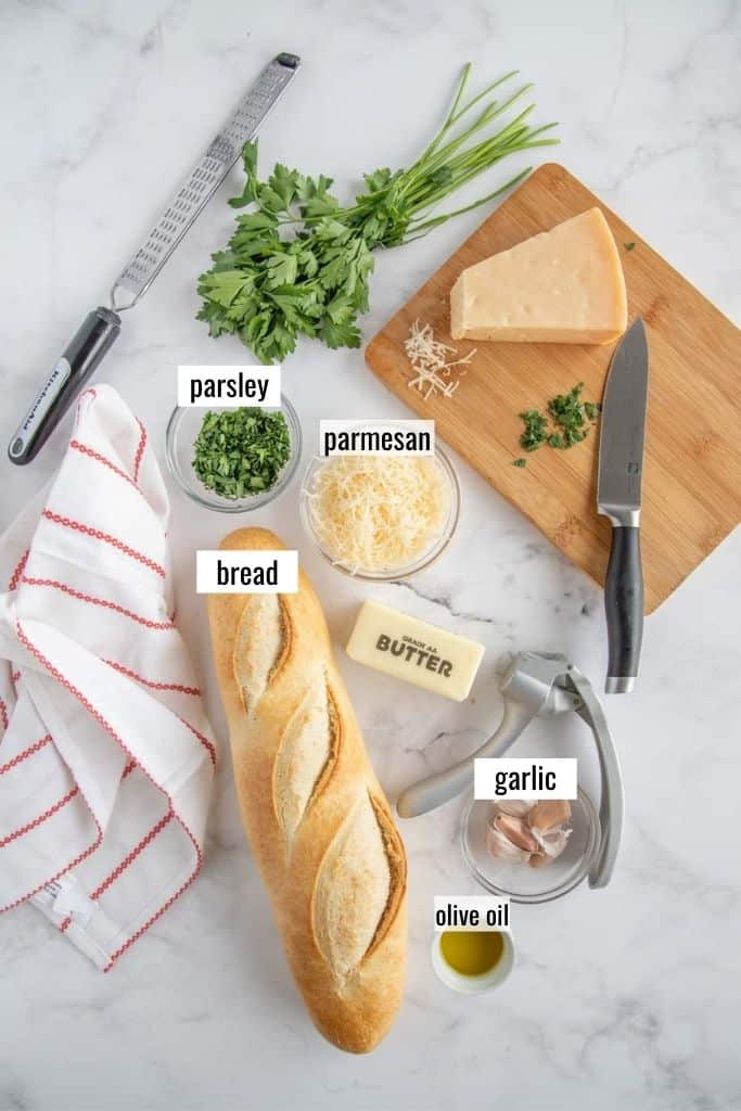 garlic bread ingredients laid out and labeled