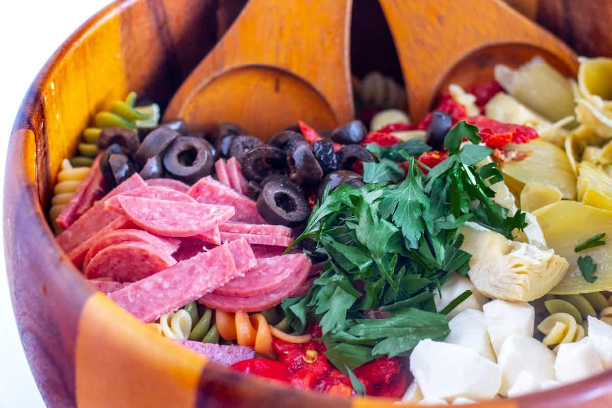 antipasto pasta salad in a wooden bowl
