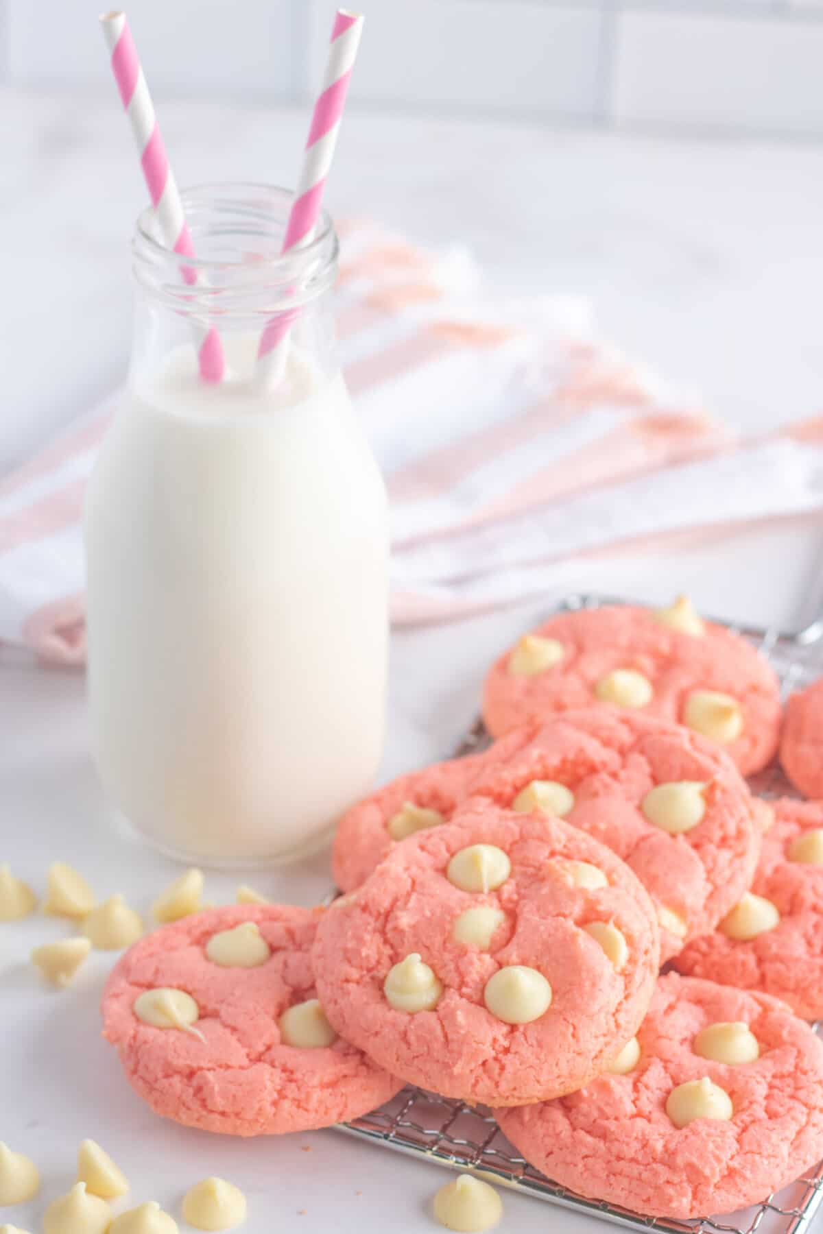 strawberry cake mix cookies with a bottle of milk
