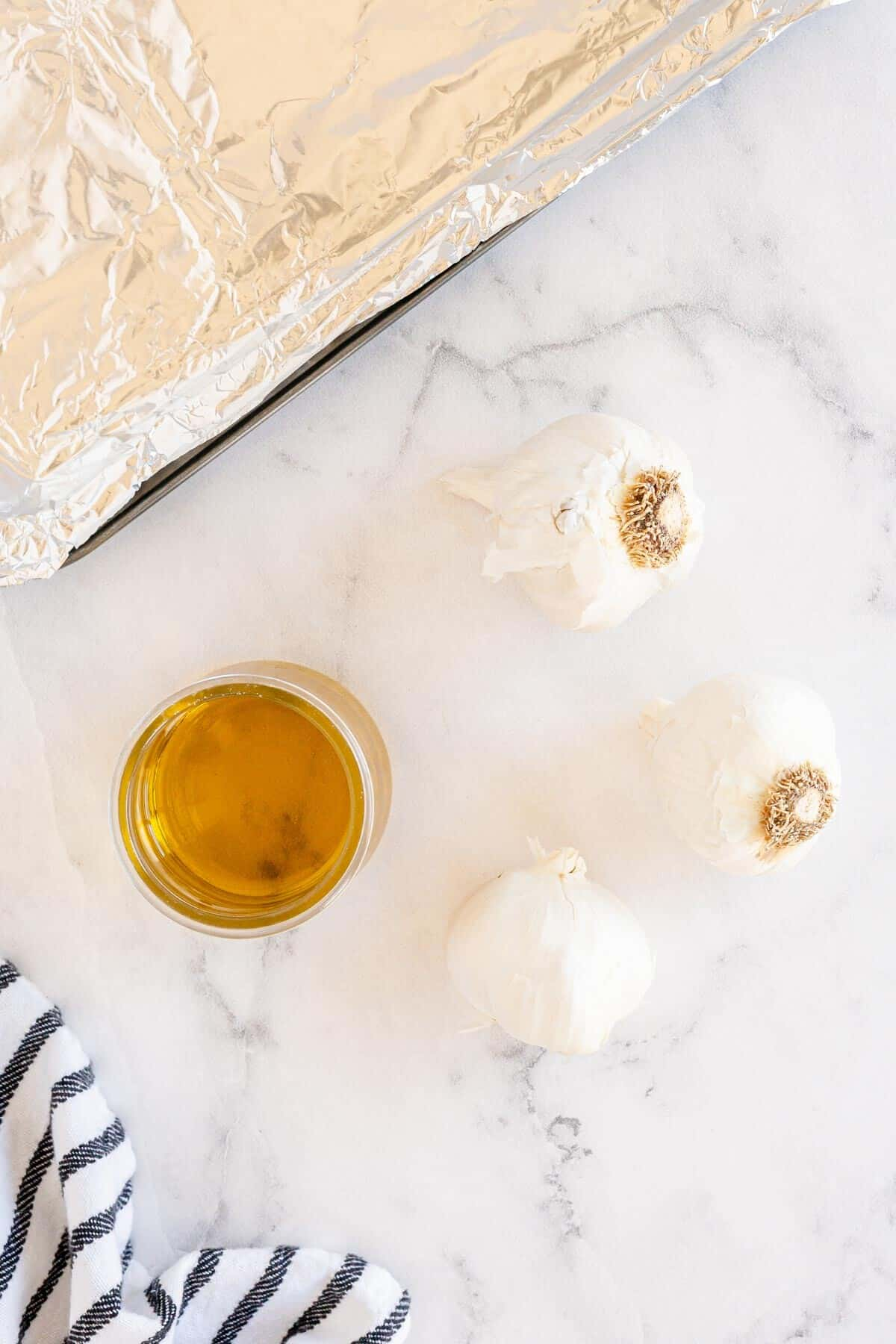 garlic and olive oil on a marble countertop