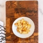 bowl with roasted garlic on a wooden board