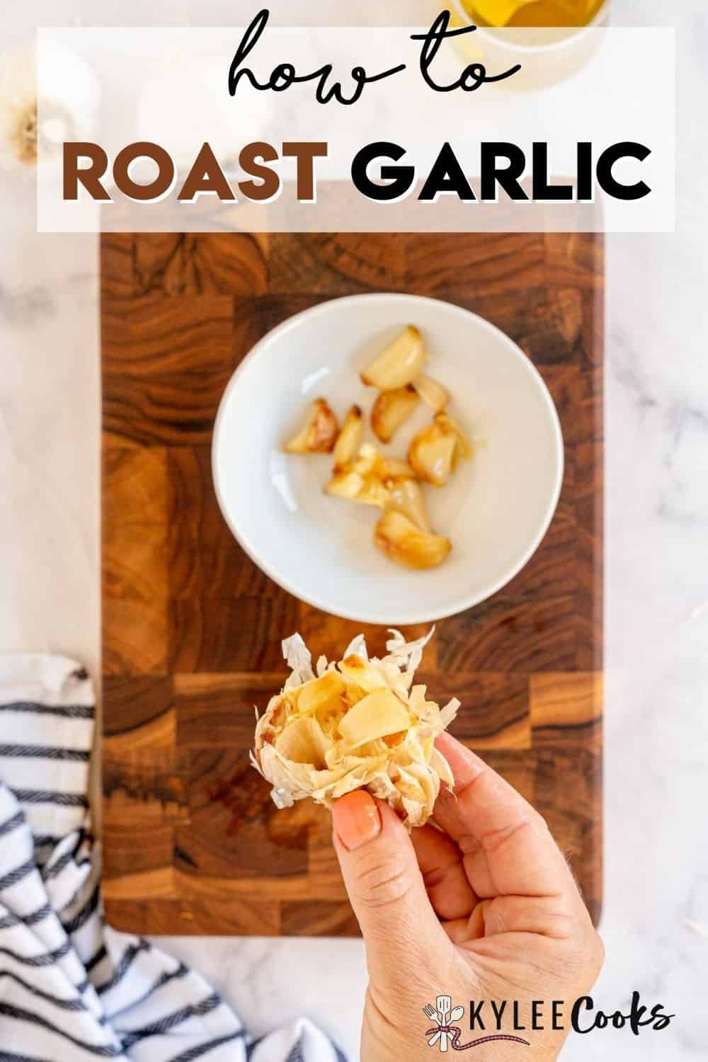 hand holding a head of roasted garlic with text overlay