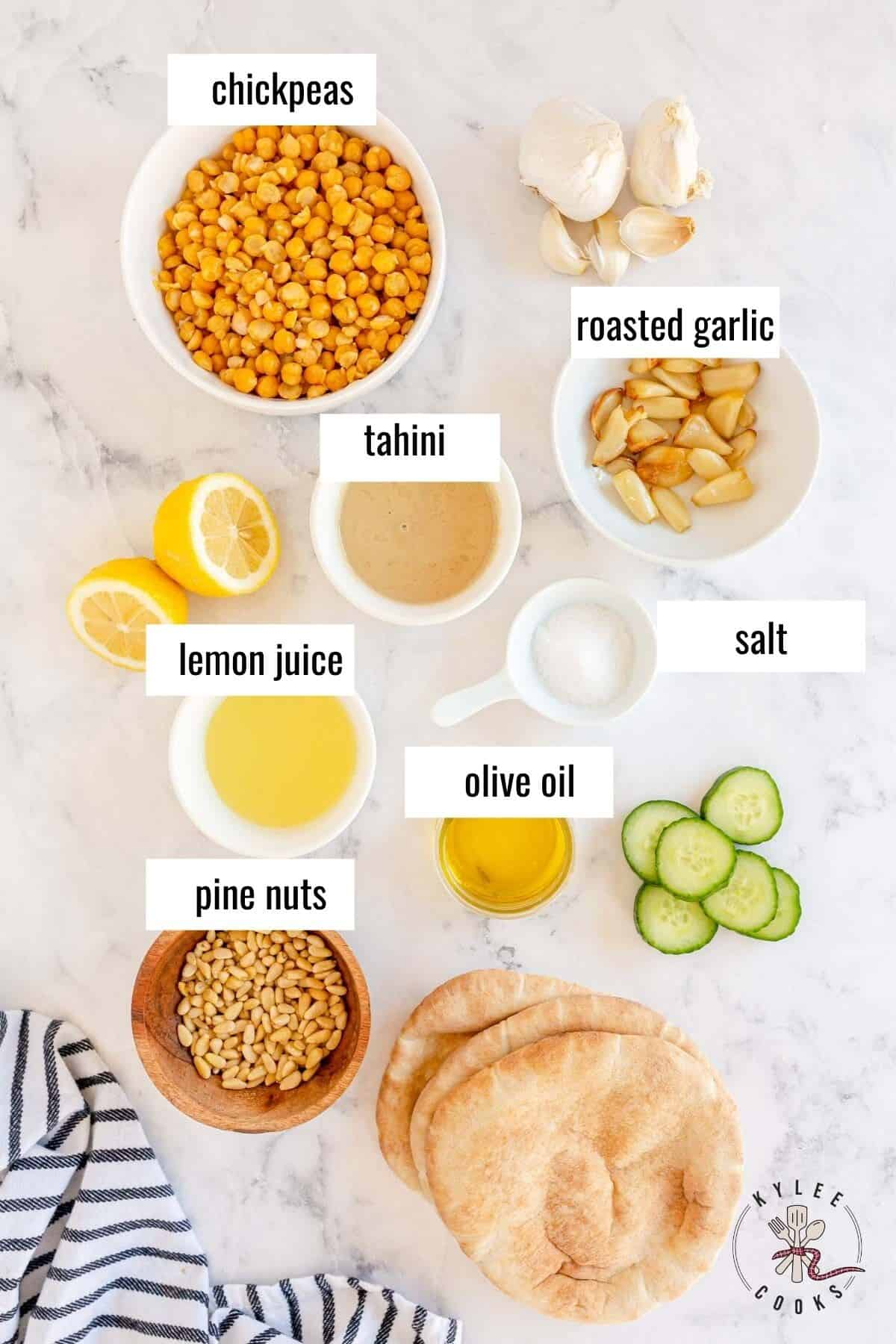 ingredients to make hummus laid out and labeled
