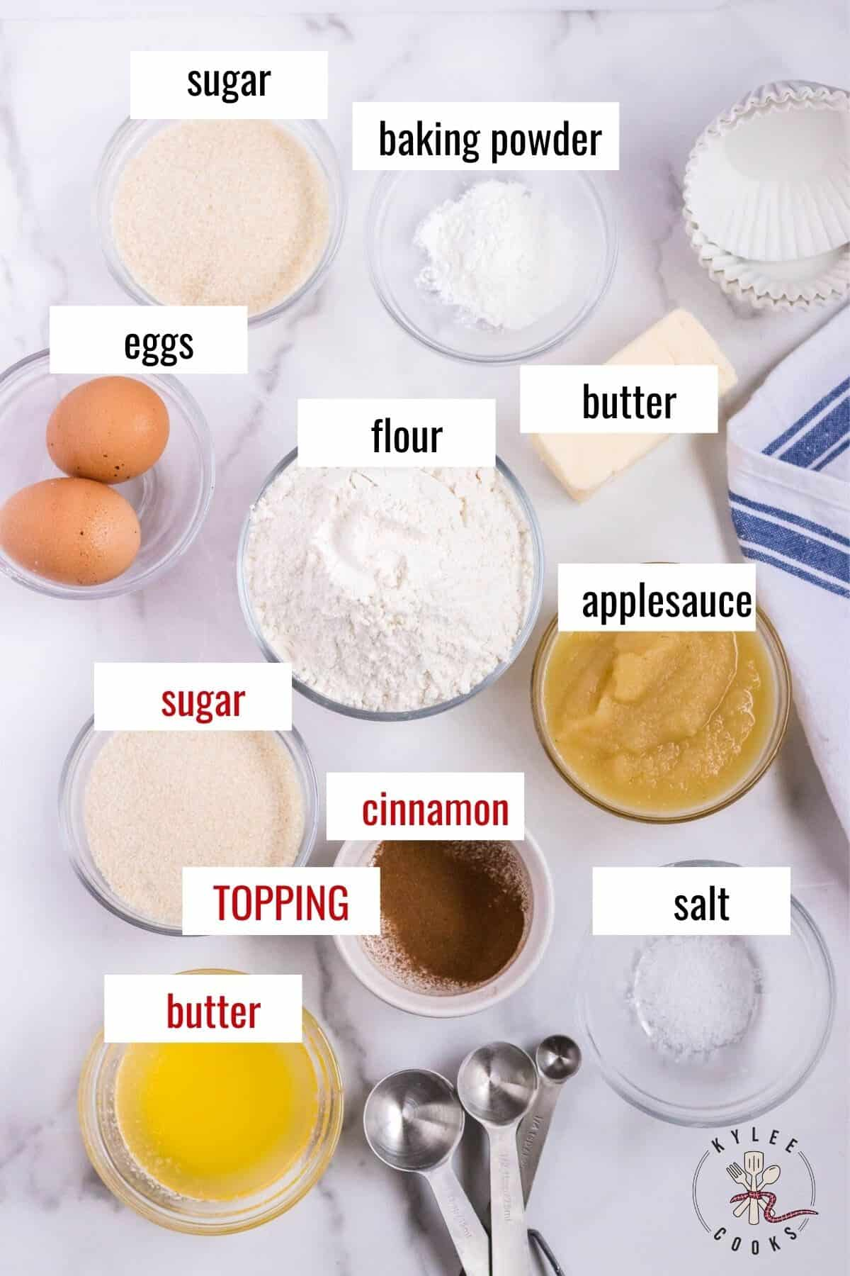ingredients to make applesauce muffins laid out and labeled